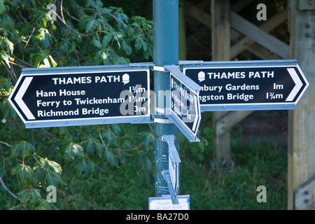 Signpost indicating the Thames Path ( National Trail ) sited by Teddington Lock, featuring Ham House and Richmond - Stock Photo