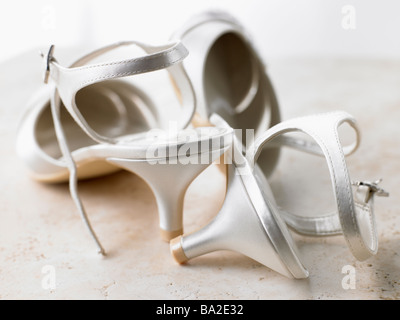 Abandoned Silver High Heels - Stock Photo