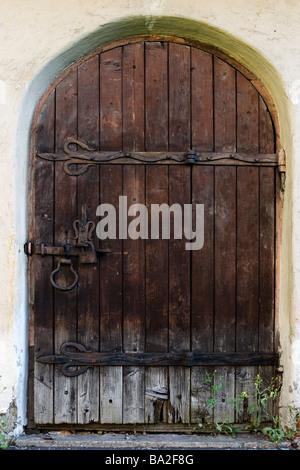 ... Barn Door · Old Medieval Arched Door.   Stock Photo