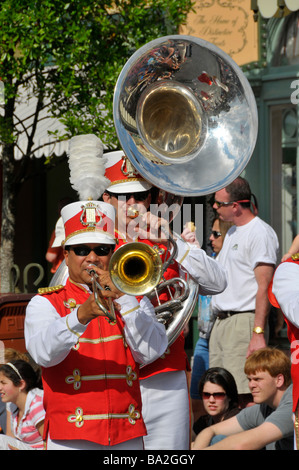 Band in Parade along Main Street at Walt Disney Magic Kingdom Theme Park Orlando Florida Central - Stock Photo