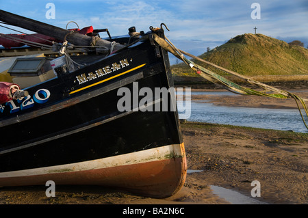The old fishing boat Marean in the River Aln estuary - Stock Photo