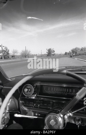 Roadside car Oldtimer steering wheel armatures detail s/w street human-empty drive vehicle private car Cadillac - Stock Photo