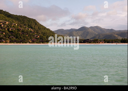 Hermitage Bay hotel from a yacht in the bay - Stock Photo