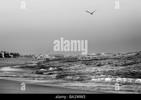 Orange Golden early morning sunshine over blue ocean waves in Delray Beach. Amyn Nasser amynnasser [room for copy] - Stock Photo
