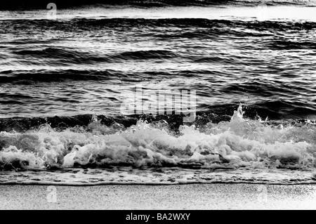 Early morning golden red reflections over splashy ocean waves. Amyn Nasser amynnasser [room for copy] artisan artisanal - Stock Photo