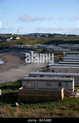 caravan mobile home park on the beach on the inishowen peninsula county donegal republic of ireland - Stock Photo