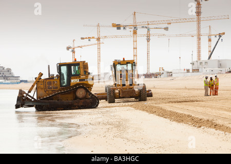 Constructing a new beach reclaimed from the sea on the Palm in Dubai,UAE - Stock Photo