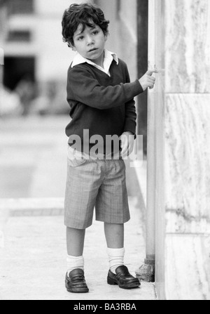Eighties, black and white photo, people, children, little boy stands near a wall, Spaniard, aged 5 to 7 years, Spain, - Stock Photo
