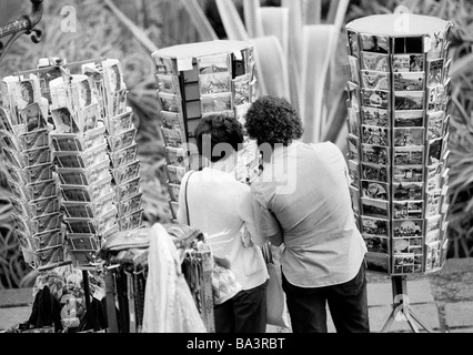 Eighties, black and white photo, people, young couple chooses picture postcards in mapstands, holidays, Spain, Canary - Stock Photo