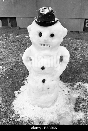Seventies, black and white photo, winter, weather, snow, snowman - Stock Photo