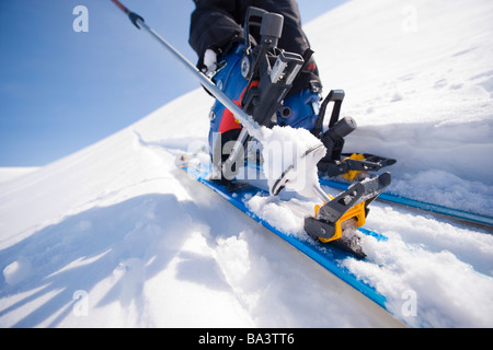 Close up of a backcountry ski and boot in motion on a trek in Alaska during Winter - Stock Photo