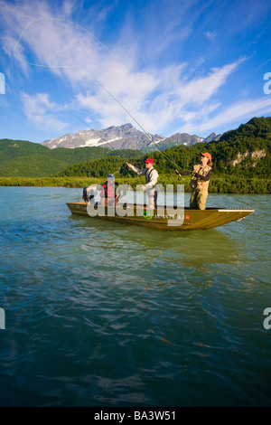 Man and woman fly fishing for salmon from boat on Big River Lakes, Summer Southcentral Alaska - Stock Photo