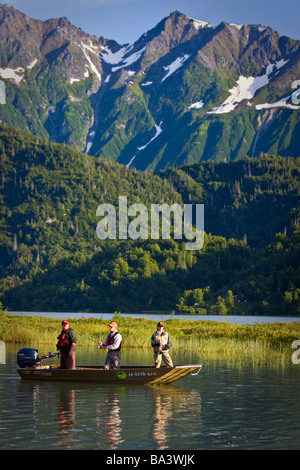 Anglers spin fish from a boat in Big River Lakes in Redoubt Bay, Southcentral Alaska during Summer - Stock Photo