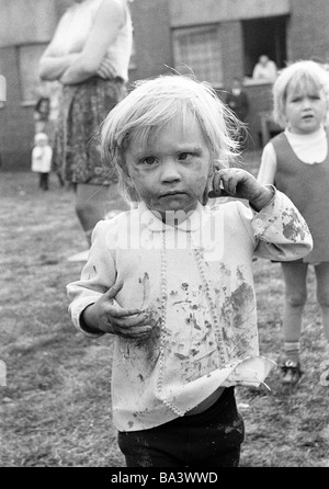 Seventies, black and white photo, people, children, little girl, portrait, street kid, dirty, unkemptly, aged 4 - Stock Photo