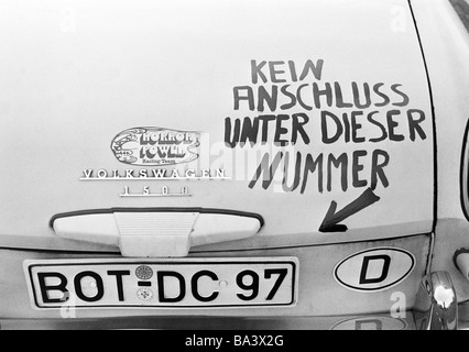 Seventies, black and white photo, humour, product photography, car painted with witty saying, hint to the vehicle - Stock Photo