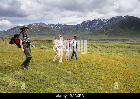 Female National Park Interpretive Ranger leads group on a *discovery hike* in the Eielson area Denali National Park - Stock Photo