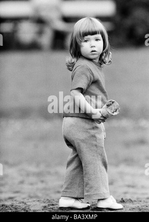 Seventies, black and white photo, people, children, little girl, aged 2 to 3 years - Stock Photo