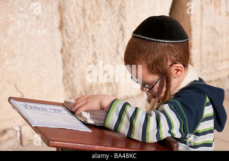 Israel Jerusalem Old City Western wall portrait of young red haired orthodox jew praying - Stock Photo