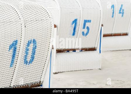 Sand wicker beach chairs numbers ten fifteen fourteen white blue woven Mecklenburg-Western Pomerania reprimands - Stock Photo