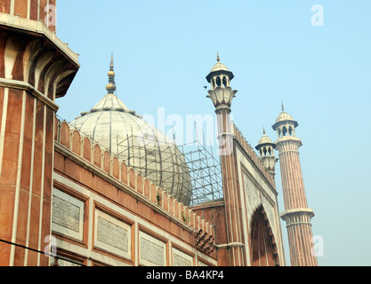 Entrance to  the great courtyard of the  Jami Masjid mosque. Marble and sandstone dome, towers and archway can be - Stock Photo