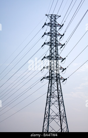 High voltage power lines, transmission tower, power tower, electricity pylon against blue sky, Fengyuan District, - Stock Photo