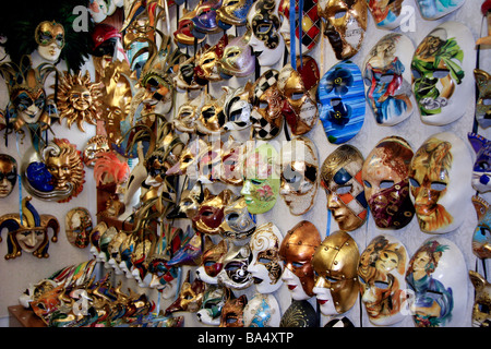 Venetian masks on display in a shop in Venice Italy - Stock Photo