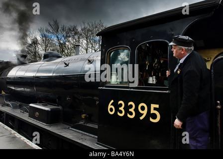 North York Moors Railway steam engine and driver. - Stock Photo