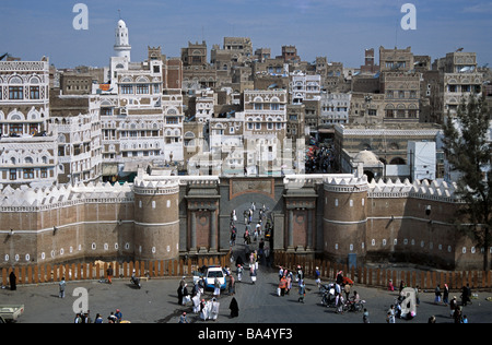 City View over Bab-al Yemen Town Gate & City Walls with Old Town & Tower Houses Beyond, Sana'a Sana or San'a, Yemen - Stock Photo