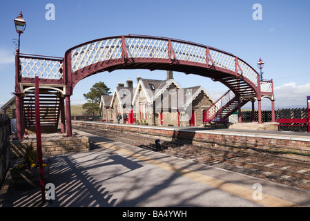 Kirkby Stephen Upper Eden Valley Cumbria England UK Old train station and footbridge on Settle to Carlisle railway - Stock Photo