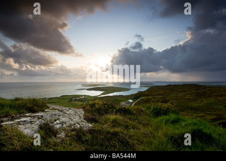 view over looking the west of ireland near the town of Clifden in the heart of conneamara County Galway at sunset - Stock Photo