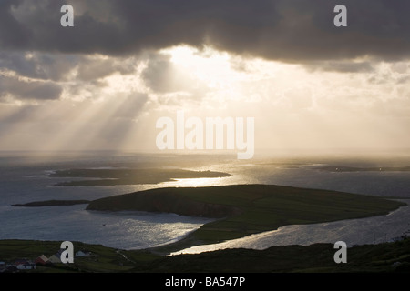 View from Sky Road near Clifden over looking the county Galway coast with a dramatic sunset - Stock Photo