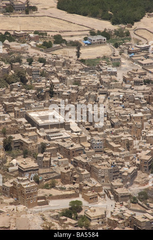 The village of Shibam as seen above from mountain town of Kawkaban, Yemen. - Stock Photo