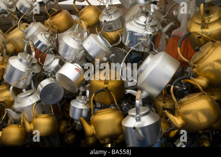 Kettles hanging on display above a storefront in the marketplace in the Old City of Sana'a, Yemen. - Stock Photo