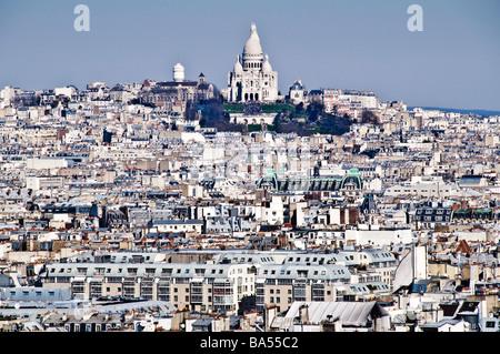 PARIS, France - Basilique du Sacré-Cœur in Paris amongst the buildings of Montmartre. View from top of Notre Dame Cathedral