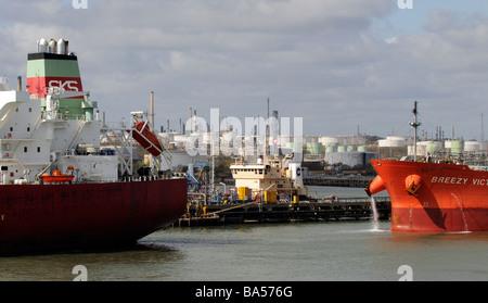 Tanker ships alongside at Fawley Refinery on Southampton Water southern England UK - Stock Photo