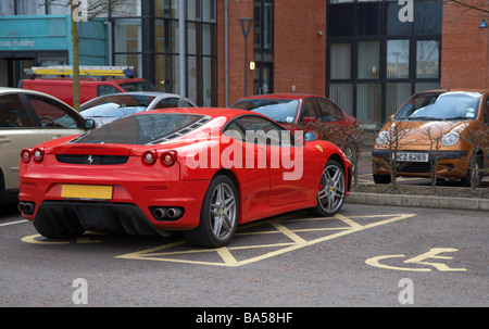 ferrari car parked inconsiderately in a disabled parking bay - Stock Photo