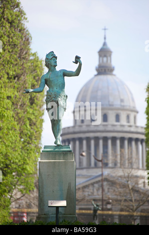 Statue of L'acteur Grec in the Jardin du Luxembourg with Panthéon in the background Paris France - Stock Photo