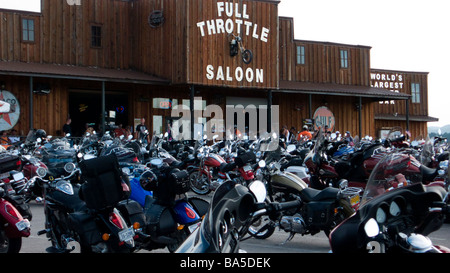 Scores of motorcycles parked outside the Full Throttle Saloon annual Sturgis Motorcycle Rally South Dakota USA - Stock Photo