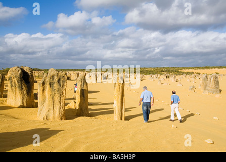 Tourists wander amongst the limestone pillars of the Pinnacles Desert in Nambung National Park.  Cervantes, Western - Stock Photo