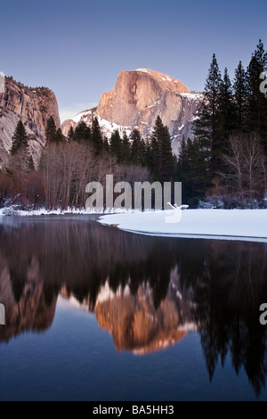 Half dome reflected in the Merced River at dusk in the winter, Yosemite National Park, California - Stock Photo
