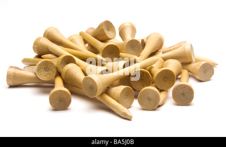 Pile of wooden golf tees against white background - Stock Photo