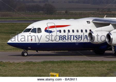 BA flight taxiing at airport - Stock Photo