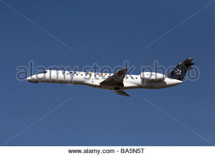 Star Alliance Embraer flight shortly after takeoff - Stock Photo