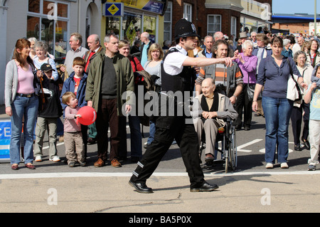 Policeman on crowd and traffic control duty in Petersfield town centre Hampshire England UK - Stock Photo