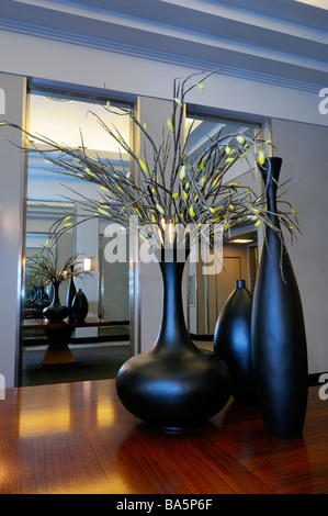 Blue light on flower vases reflected infinitely in mirror room of the seventh floor renovated Art Moderne Carlu - Stock Photo