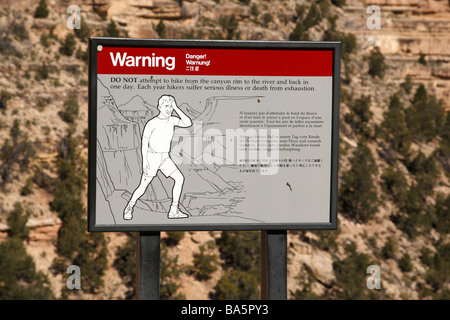 warning sign to hikers not to hike too far in a day on the bright angel trail grand canyon national park arizona - Stock Photo