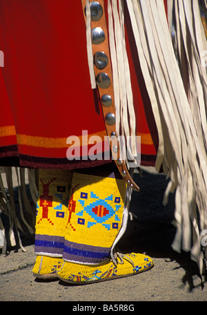 Costume detail of female dancer at Crow Fair pow wow in Montana - Stock Photo