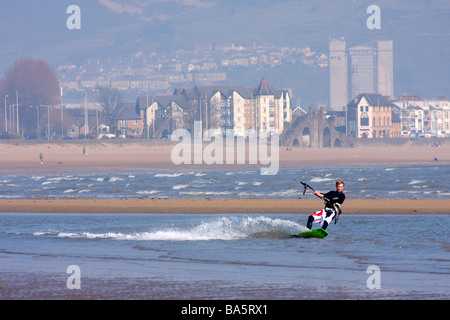 Young man kite surfing in Swansea Bay South Wales UK - Stock Photo