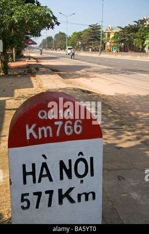 Milepost in Kilometers showing the distance from Quang Tri to Hanoi on the National Highway 1 Vietnam - Stock Photo