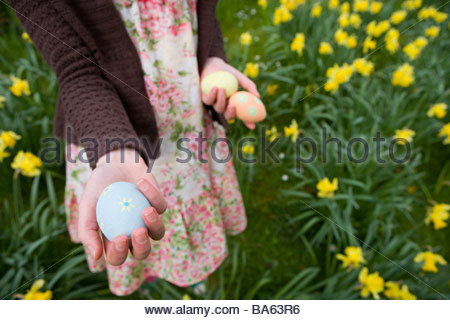 Young girl holding decorated Easter eggs - Stock Photo